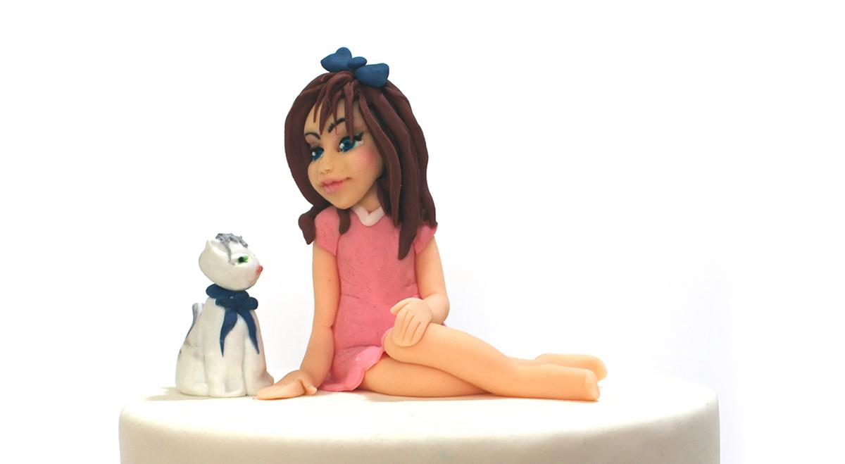 פיסול של ילדה מבצק סוכר של עוגיגה